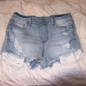 High wasted Ripped blue jean shorts